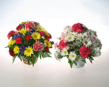 A wicker basket filled with bright and beautiful seasonal fresh flowers