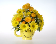 Your recipient will be all smiles when they receive this keepsake mug with fresh flowers