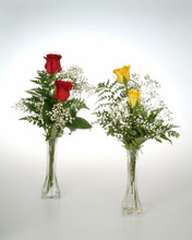 Lavish and colorful double rose vase with greens and beautiful filler