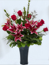A classic combination of roses and lilies with a sophisticated look.