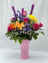Brighten their day with a stunning combination of seasonal floral