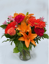 Express your caring thoughts with this graceful arrangement that includes one of the year's most popular colors