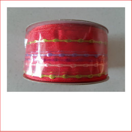 Christmas Ribbon Red with Coloured Stripes 38mm is a beautiful bright and vibrant coloured carnival range