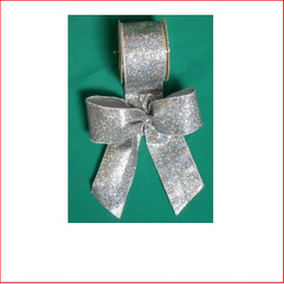 Silver Lame with Sparkles-65mm Single Bow looks great with the final touch of the glitter which sparkles through the bow. Silver Lame with Sparkles-65mm Single Bow is pre made by our designer team to suit all garlands, wreaths, christmas trees and wall sequoia's. Silver Lame with Sparkles-65mm Single Bow is very classy and a favourite for corporate clients. The colour silver is stylish and contemporary