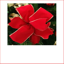 The Red Velvet with Gold Trim -75mm Double Bow is a traditional colour which is very popular as the traditional colour red is a colour that doesn't outdate. The Red Velvet - Gold Trim - 75mm Double Bow is pre made by our designer team to suit all garlands, wreaths, christmas trees and wall sequoia's. Red velvet is very classy and a favourite for corporate clients.