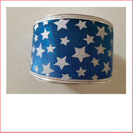 Christmas Ribbon  Blue and Silver Stars -65mm looks great with the final touch of the silver stars. Christmas Ribbon  Blue and Silver Stars -65mm is a ribbon that is used very frequently with our designer team decorating garlands, wreaths, christmas trees and wall sequoia's. Christmas Ribbon  Blue and Silver Stars -65mm are colours blue and silver that are just magical as blue and silver are the contemporary trend of this day and age.