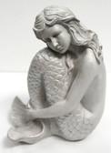 Thoughtful White Mermaid Hugging Tail