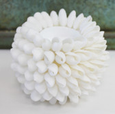 white bubble shell candle