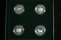 1999 CATS OF CANADA FROSTED PROOF 4-COIN 50-CENT SET ISSUED BY THE ROYAL CANADIAN MINT