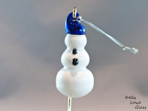 Snowman ornament with a blue cap by glassblower Kelly Lowe.