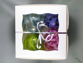 Box of four hand blown ornaments by Kelly Lowe.