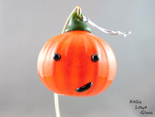 Blown glass jack-o'lantern by Kelly Lowe.
