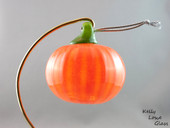 Blown glass pumpkin by Kelly Lowe.