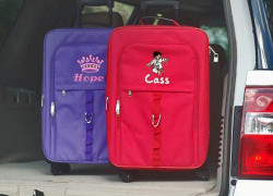 Kids 4 wheel spinner carry-on luggage with free personalization.