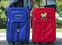 Kids Luggage in blue and red featuring rolling carry-on with free personalization for boys and girls.