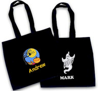 Halloween totes in black personalized with names and one with ghost and other with the pumpkin moon.