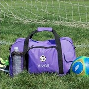 Kids Duffel Bag in purple. Great for kids in sports.