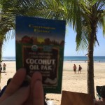 Sharon enjoys lunch on the beach in Costa Rica with a Coconut Oil Pak.