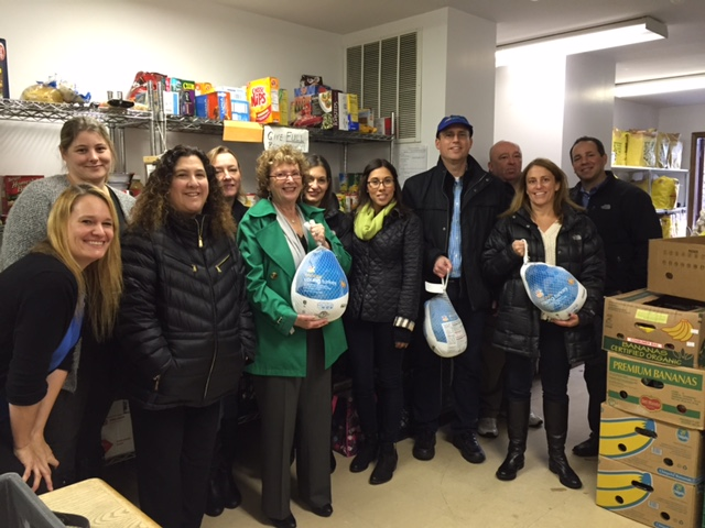 The staff of Carrington donating food.