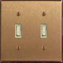 satin-bronze-plate-ivory-switches.jpg