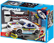 Car Repair Shop and Race Car with Headlights