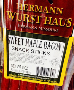 It is hickory smoked and made with pork, beef, seasonings, spices, added maple flavor and house Grand Champion bacon. Shelf stable, available in single serving 1 oz. packages.
