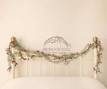 Christmas headboard scene,warm cream  vintage iron bed with festive Xmas garland