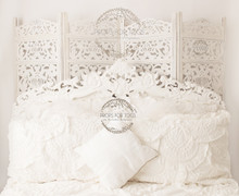 gorgeous white bed set up with carved room divider