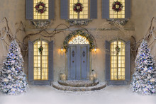 stunning christmas backdrop,vintage christmas house  with gorgeous blue doors and christmas trees.