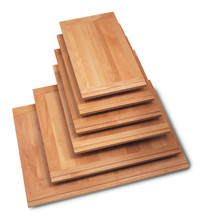Laminated Alder hardwood breadboards with Alder finger pull on one end and an Oak finger pull on the other.