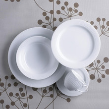Contemporary design in white with a subtle circular embossed rim on a fine white porcelain body. Arctic White is a stylish pattern that is versatile enough to be used as a casual breakfast setting or can just as easily be 'dressed up' for formal dining. There is a wide range of accessories to compliment the dinnerware and all items are chip-resistant, dishwasher and microwave safe. Gift boxed 20 piece dinner set comprising 4 x tea cups (Lge), tea saucers, entrée plates, dinner plates and soup plates.
