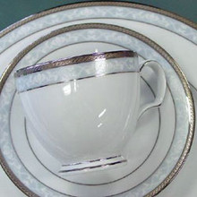 This magnificent formal design comes packed full of features. A delicate 'raised' lace pattern adorns an 'ice blue' coloured sleek satin band, surrounded by a classy embossed platinum trim. The elegant cup (European 'bulb' style) and soup bowl (23 cm classical rim) are fantastic new shapes and add considerable appeal to the set, as does the gift box.Hampshire Platinum harkens back to the golden age of Noritake tableware design with it's outstanding technique and appearance. It is outstanding value for money for product this good and proves once again that nobody does affordable fine china better than Noritake!Set consists of 4 x teacups, saucers, entrée_©e plates, dinner plates and rimmed soup plates all chip resistant.
