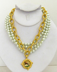 Rosette necklace with pearls and gold