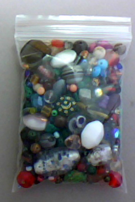 Beada Treasure Hunt 3x4inch Ziplock  6 Oz! A multinational mix of Czech, German, Indian & Japanese Glass Beads, as well as some unexpected treats, coral, amazonite, malachite, unakite, (I'm poking thru one as I type) There's even some clasps, and some other findings, pun intended, in these mixed bead treasure hunts.