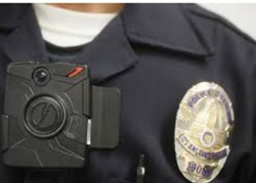 Image of a police officers chest showing Taser Axon Body Cam in use
