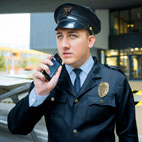 Police officer dictating into the Philips SpeechAir Smart Voice Recorder
