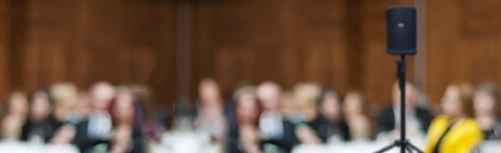 Background with blurred out conference attendees