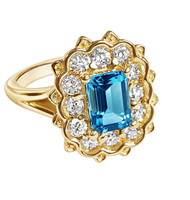 Emerald Cut Blue Topaz Floral ring surrounded by 1/2ct diamonds set in 14K Yellow Gold