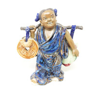Ceramic Figure Carrying Coin and Fruit