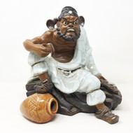 Ceramic Figure Man Sitting
