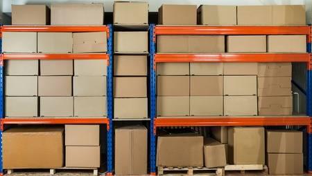 43306178-cardboard-boxes-on-shelves-in-distribution-warehouse.jpg