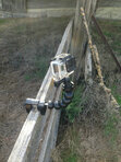 flexible gooseneck camera mount clamped on a fence