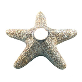 """This is an 8"""" Starfish with a glass T-light insert filled with slow burning was."""