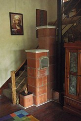Six inch Dragon Rocket Masonry Heater with an oven and a single bell for heat capture. The tall stove pipe facilitates radiant heat of any surplus heat not captured by the bell tower. The decorative plaster finish has not been applied.