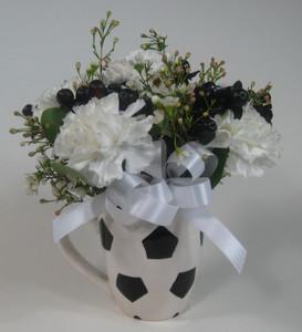 floral arrangement in soccer ball mug