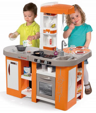 Children using the kids Smoby Tefal Cuisine Studio XL Bubble Play Kitchen