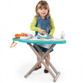 A young child using the Smoby ironing board and steam iron with realistic steam sound effect 330118