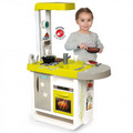 A child playing with frying pan included with the Cherry Play Kitchen from Smoby toys