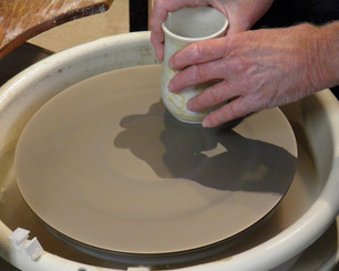 The disc attaches to the potter's wheel with the included bat.