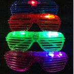 Multi Color Flashing Shutter Novelty Glasses 12 per   .60